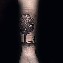 man-walking-dog-under-tree-mens-forearm-tattoos.jpg