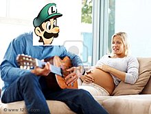 6800049-mature-man-plays-guitar-his-pregnant-wife-home.jpg